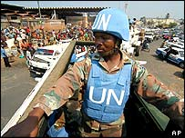 South African UN peacekeepers patrol the streets around the central market in Bujumbura