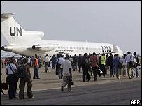 UN staff boarding a plane