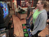 Mark Shephard and Stephanie Bellman try out DDR, AP