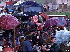 Albanian refugees and lorries leaving Kosovo