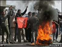 Pro-democracy protesters burn a tyre in Kathmandu