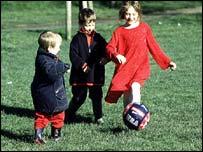 children kicking ball