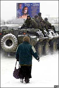 Russian army armoured personnel carrier (APC) patrols a street in Grozny, 27 January 2006