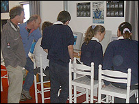Children and teachers examining the results and pictures from Deep Impact at the Spaceguard Centre