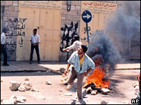 Palestinians throw stones during the first intifada in 1988