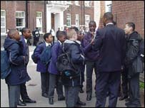Teacher talking to pupils