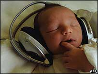 Newborn listens to music