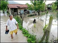 A man walks through flood waters in Venchan, north-east Bulgaria