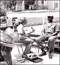 Cameraman Mo Amin films Mike Wooldridge and Yoweri Museveni in 1986