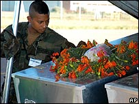 A Guatemalan UN peacekeeper look at the caskets of fellow soldiers