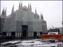 Snowplough outside Duomo in Milan