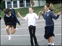Children skipping in a playground