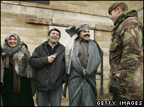 British Afghans share a joke with a British soldier on Salisbury Plain