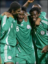 John Mikel Obi (centre) celebrates with his Nigerian team-mates
