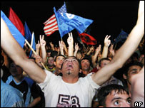 Supporters of the Democratic Party (PD) cheer outside party headquarters in Tirana, Albania