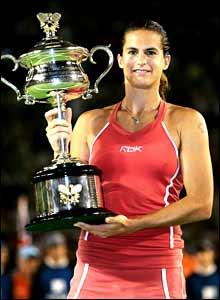 Amelie Mauresmo holds aloft her Australian Open trophy