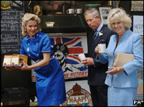 The royal couple with Nell McAndrew, dressed as a Naafi girl