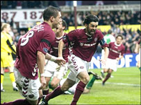 Paul Hartley (right) celebrates his opening goal
