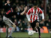 Sunderland's Gary Breen and Brentford's DJ Campbell