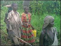 Woman leading blind man