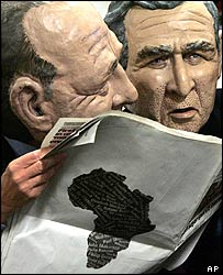 Actors with masks of the French and US presidents read an article about Africa