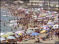 Crowds on the beach at Benalmadena, Costa del Sol
