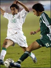 Morocco's Youssef Hadji (left) battles with Libya's Nader Tarhuni
