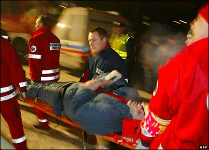 Rescuers rush an injured man to hospital