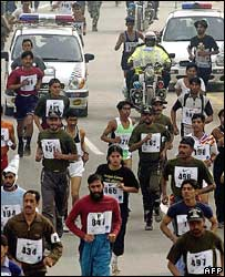 Police escort athletes in Lahore mixed-sex mini marathon