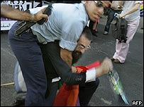 Religious protester wrestled to the ground by police