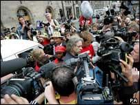 Geldof talks to the media outside Edinburgh's Waverley Station
