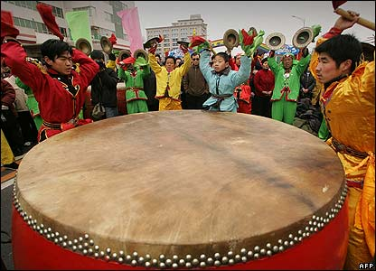 Performers beat a drum in Beijing, China