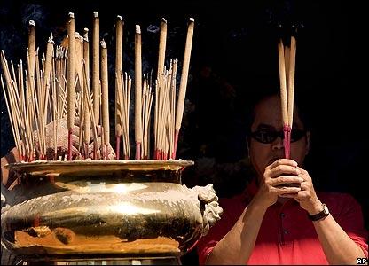 Ethnic Chinese burn incense sticks in Kuala Lumpur, Malaysia
