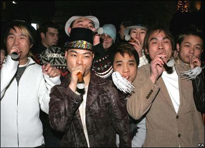 Revellers celebrate in Trafalgar Square