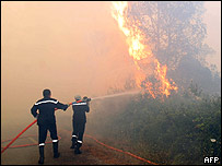 Firemen fight a fire in Puget-sur-Argens, French Riviera