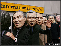Protestors wearing masks of G8 leaders