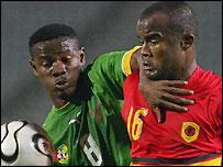 Togo's Abdoul Gafar Mamah (left) tangles with Angola's Flavio