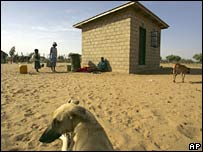 Hut and family in the Kalahari desert.  Image: AP