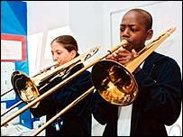 Children playing trombones