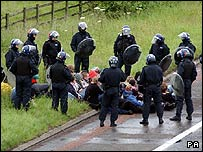 Riot police contain G8 protesters on the M9 motorway near Stirling on the route to Gleneagles