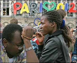 People watch a live retransmission of the IOC decision outside the Paris town hall