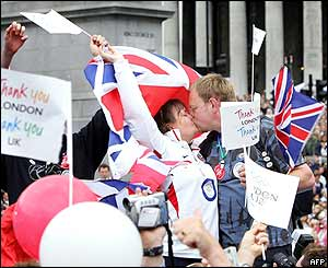 A London couple kiss in celebration in Trafalgar Square after it is announced the city won its bid to host the 2012 Olympic Games