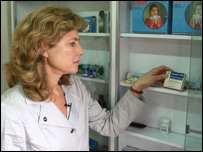 Olenka Frenkiel looking at drugs on a shelf