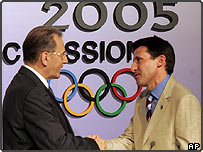 Lord Sebastian Coe, right, president and chairman of London 2012 bid, shakes hands with IOC President Jacques Rogge