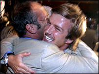 London 2012 ambassadors Sir Steve Redgrave and David Beckham celebrate in Singapore