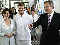 Prime Minister Tony Blair (right) presses the flesh with his wife Cherie and footballer David Beckham (centre)