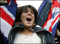 A woman celebrates wrapped in the flag