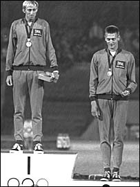 Britain's 400m hurdles gold medallist David Hemery, flanked by bronze medal winner John Sherwood at the 1968 Olympics