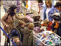 US shoppers picking goods from sale baskets