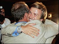 Sir Steve Redgrave and David Beckham embrace